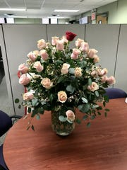 A bouquet of 43 roses B/A Florist delivered to East Lansing city employee Jennifer Shuster on Feb. 24 were paid for by an anonymous customer in honor of his late wife. For years he ordered the flower arrangement for her every February, said  B/A Florist owner Laurie Van Ark.