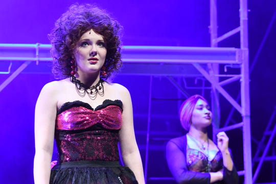 Matti Lynn Chrisman rehearses a scene from Rock of Ages on Monday evening at the Renaissance Theatre.