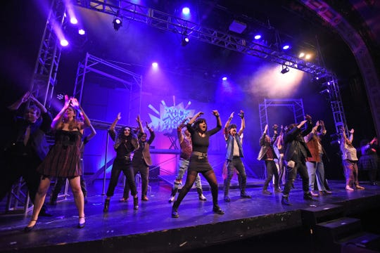 The cast of Rock of Ages rehearse Monday evening at the Renaissance Theatre.