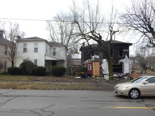 """The house at 205 Silver Street, right, was destroyed in a January fire and has been deemed a """"dangerous building,"""" a nuisance and a safety hazard by city officials. The fire also melted off part of the siding on the neighboring house at 201 Silver Street, left."""