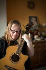 Vanessa Prentice used to sing and perform with her daughter Stella Abel who was 15 years old when she killed herself in November 2018. She was a popular student at Marysville, in the band, artistic, and smart. Photographed at her home in Marysville, where she has photos and a memorial for her daughter, Thursday, February 20, 2020.