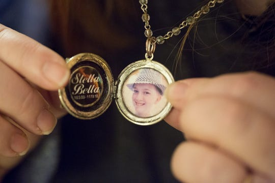 Vanessa Prentice wears a locket with her daughters picture in it. Stella Abel was 15 years old when she killed herself in November 2018. She was a popular student at Marysville, in the band, artistic, smart, and she was known around Columbus because she would sing gigs with her mom, Vanessa Prentice. Photographed at her home in Marysville, where she has photos and a memorial, Wednesday, February 5, 2020.