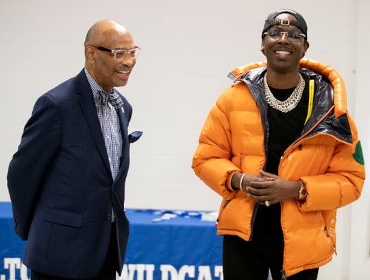Principal James Bacchus I introduces Young Dolph to a room of student athletes, faculty and alumni Tuesday, March 3, 2020, at Hamilton High School in Memphis. Young Dolph, an alum of Hamilton High School, made a donation of $25,000 to the school's athletic account.