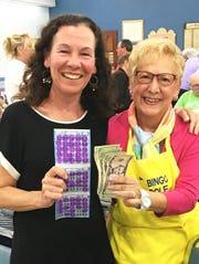 JCMI's big winner Ruth Sutton with Bingo committee member Carol Atkin.