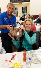 On Feb. 27, the Knights of Columbus San Marco Council #6344 hosted a Bingo Night in the San Marco Parish Center. The Coach bag winner was Mary Tremble of Massachusetts, above, with Knight Steve Vasco.