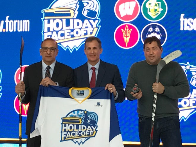 Announcing the Holiday Face-Off hockey tournament at Fiserv Forum on March 3, 2020, were (from left) Gazelle Group president Rick Giles, Badgers head men's hockey coach Tony Granato and Bucks/Fiserv Forum president Peter Feigin.