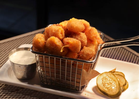 Cheese curds are displayed as the Milwaukee Brewers  unveil Restaurant To Be Named Later. The menu aims for a Wisconsin theme.