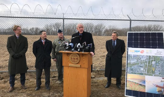 Milwaukee Mayor Tom Barrett announces a new solar project on part of a city-owned closed landfill at 1600 E. College Ave. near Mitchell International Airport Tuesday. With him from left to right are Ald. Scott Spiker, city Director of Environmental Sustainability Erick Shambarger, Colonel James Locke of the Air National Guard 128th Air Refueling Wing and President and Chief Executive Officer of WEC Energy Group Kevin Fletcher.