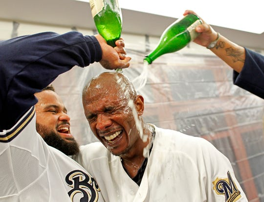 Prince Fielder gives 10th-inning hero Nyjer Morgan a bubbly shower after the Brewers defeated the Diamondbacks, 3-2,  on Oct. 7, 2011, to win the National League Division Series.