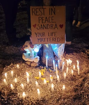 Mourners created a roadside memorial for Sandra Skenandore, 36, of Milwaukee after she was killed in a hit-and-run crash at the intersection of South 1st Street and South Chase Avenue on March 1.