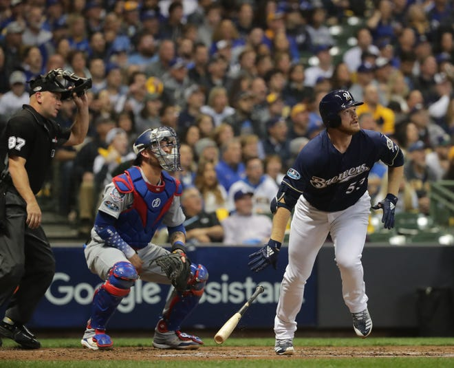 Brewers pitcher Brandon Woodruff watches his home run off the Dodgers' Clayton Kershaw in Game 1 of the 2018 NLCS.