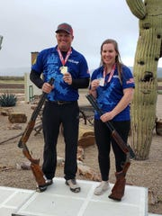 Madelynn Bernau of Waterford, Wis. poses with Derek Mein of Kansas on Monday at the U.S. Olympic selection event in Tuscon, Ariz. Both earned spots on the U.S. trapshooting team for the 2020 Tokyo Games.