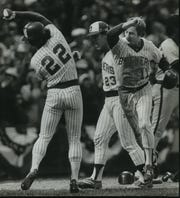 Charlie Moore (22) and Jim Gantner exchange high five after scoring off Cecil Cooper's single in the seventh inning of Game 5 of the 1982 American League Championship Series.