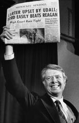 1976: Jimmy Carter holds up an early edition of the Milwaukee Sentinel the day after he pulled out a close victory in the Wisconsin primary over Morris Udall. This photo was published in the April 7, 1976, Milwaukee Journal.