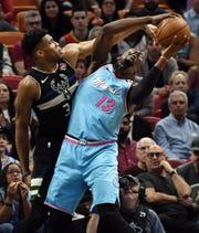 Bucks forward Giannis Antetokounmpo defends Miami Heat forward Bam Adebayo in the first quarter.