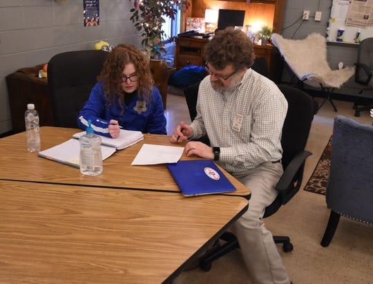 Mountain Home senior Grace Beckham reviews an AP Calculus problem with teacher Garrett Rucker on Feb. 24. Beckham and Garrett had just completed an interview with The Bulletin regarding Beckham being chosen as a National Merit Finalist.