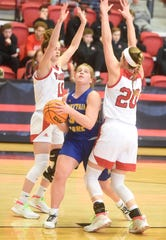 Mountain Home's Addison Yates splits two Vilonia defenders during the Lady Bombers' victory on Tuesday.