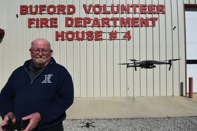 Buford Fire Chief Will Syfrett flies one of the department's two new drones. Syfrett said the department expects the drones to be useful in search and rescue and other incidents firefighters respond to.