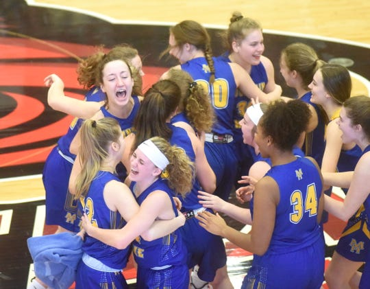 The Mountain Home Lady Bombers celebrate after defeating the Vilonia Lady Eagles, 50-43, in the first round of the Class 5A State Tournament on Tuesday at Russellville.