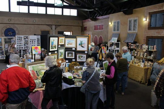 Local art enthusiasts gather to look over selections at the 2019 Pike Road Art Market. The ninth annual Pike Road Art Market is set for Saturday.