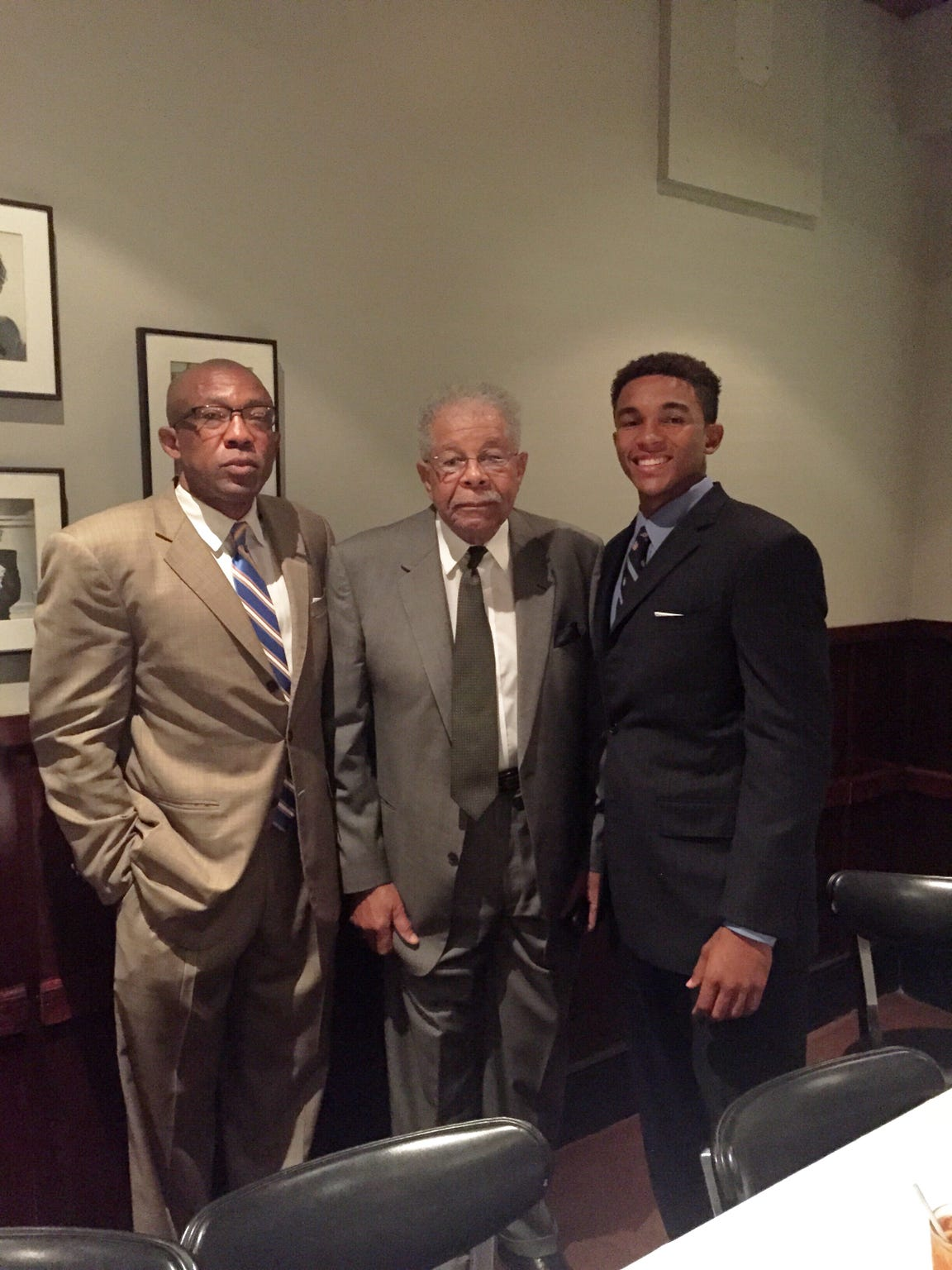 Don Jackson (left) stands with his father (middle) and his son Trey (right).