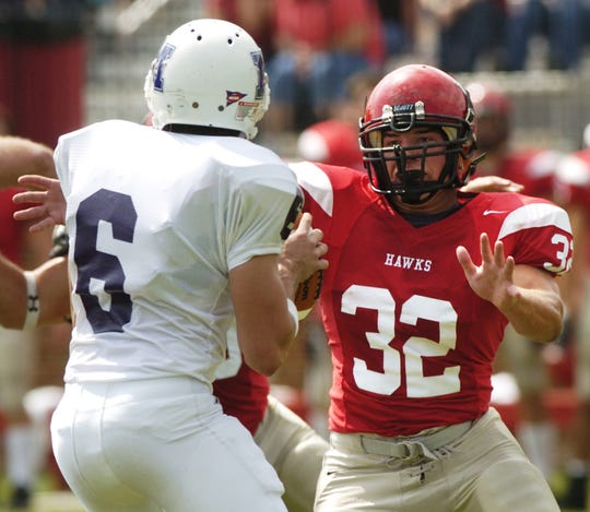 Millsaps' #6, Billy Bob Orsagh, was pressured by Huntingdon's #32, Granger Shook, during the first quarter of their game at Huntingdon's Charles Lee Field in Montgomery, Alabama on Saturday, October 1, 2005.
