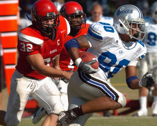Faulkner receiver Luther Burton (80) runs from Huntingdon's Granger Shook (32) at Huntingdon College Saturday, Oct. 13, 2007, during the first meeting between Huntingdon and Faulkner University.
