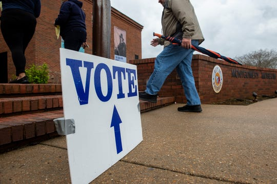 Voters make their way to the polls at Montgomery Museum of Fine Art in Montgomery, Ala., on Tuesday, March 3, 2020.