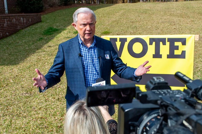 Jeff Sessions talks with the media after voting in Alabama's primary election, Tuesday, March 3, 2020, in Mobile, Ala. The former Attorney General is part of a seven person field in the state's Republican Senate primary jockeying for the GOP nomination and the right to challenge Democratic Sen. Doug Jones in November. (AP Photo/Vasha Hunt)