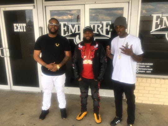 From left, artist LoopBoi Twin, Empire owner Patrick Adair, and artist SMG Money Mane at the front entrance of Empire Entertainment Center on South Boulevard in Montgomery.