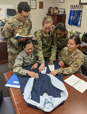 Air University Squadron Officer School students Capt. James Flores-Lombay, Capt. Jessica Sunkamaneevongse, Capt. Kristen Ricker, Capt. Tanisha Bramwell-Boose and Air Force Office of Special Investigations Special Agent Alexandra Garced signed up to take the Air University Advanced Research elective to research a redesign of the maternity service dress uniform. The Diversity and Inclusion topic of the elective also includes researching how to reimburse the cost of shipping mother's milk home for female Airmen on short temporary duty assignments. The two topics are being studied at the request of the Air Force Women's Initiative Team, which promotes diversity and inclusion in the Air Force.