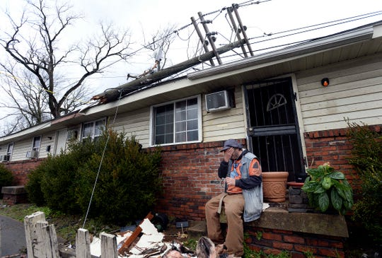 Richard Price starts to cry as he takes a break from cleaning up around his house after a tornado damaged the front of it on Tuesday, March 3, 2020, in N.Nashville, Tenn.