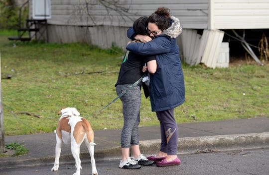 Residents comfort each other afterseveral homes were destroyed by a tornado near 16th Avenue N and Underwood Street on Tuesday, March 3, 2020, in N.Nashville, Tenn.