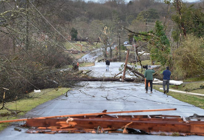 Residents along Lumar Ln. survey the damage after a tornado ripped through the Donelson neighborhood  Tuesday, March 3, 2020 in Nashville, Tenn.