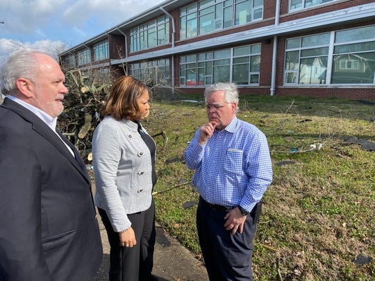 Metropolitan Nashville Public Schools Director Adrienne Battle converses with Nashville Mayor John Cooper while assessing the damage at Robert Churchwell Museum Magnet Elementary School in North Nashville.