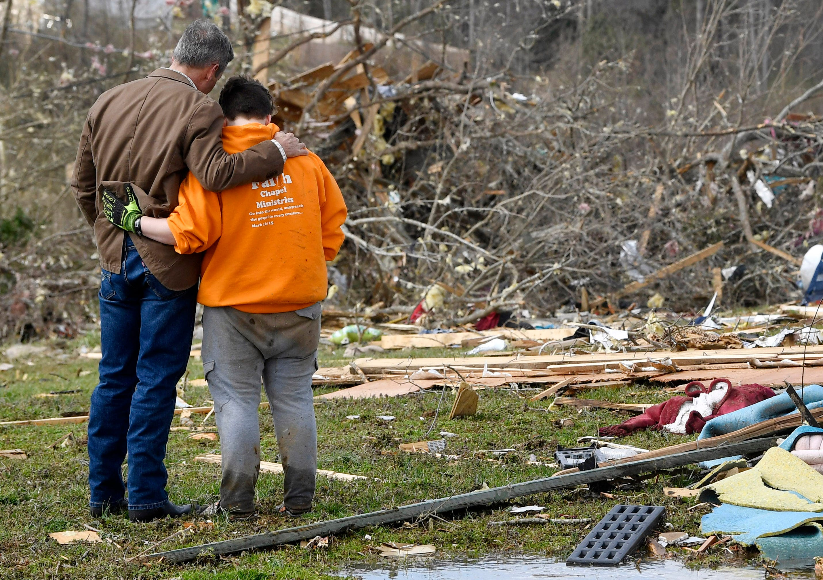 Gov. Bill Lee hugs Putnam County resident Kayla Cowen as he says a prayer with her after she told him she was trying to find something to salvage after losing her apartment and helping to identify a neighbor who was killed by the tornado Tuesday, March 3, 2020.