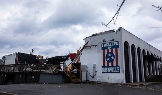 """At Basement East, the building's face still stood, as did the """"I Believe in Nashville"""" mural painted on the side of the building. The middle had been picked up and blown away."""