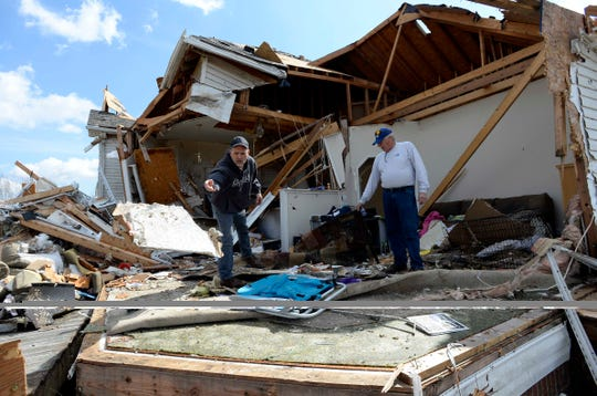 Chris Mabry, left, looks for personal belongings after a tornado destroyed his home in the West Heaven sub division on Tuesday, March 3, 2020, in Putnam County, Tenn.