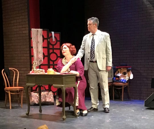 "Mama Rose (Becca McCoy) fights to keep the agent who loves her (Tom Wallace) in the TheatreZone production of ""Gypsy."""