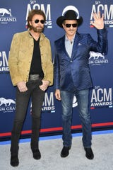 Ronnie Dunn, left, and Kix Brooks of Brooks & Dunn, walk the red carpet at the 54TH Academy of Country Music Awards Sunday, April 7, 2019, in Las Vegas, Nev.