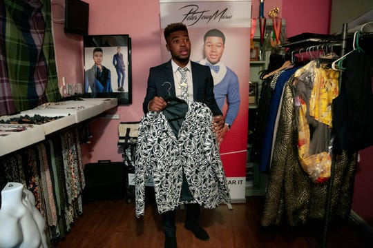 Fashion designer Peter Jean-Marie shows off a jacket he created during an interview, Tuesday, March 3, 2020, at his home in East Naples.