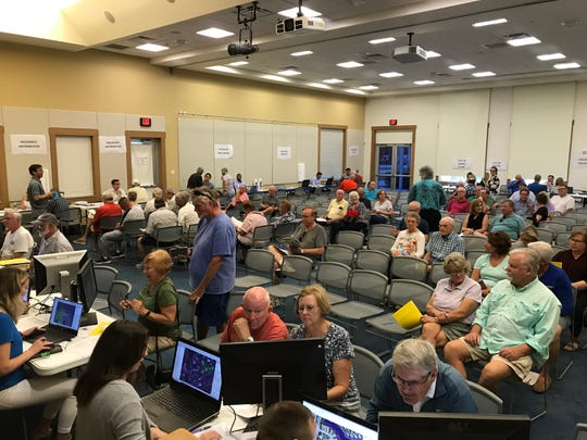 Residents and property owners gather at the South Regional Public Library Monday, March 2, 2020, to find out what new draft flood maps could mean for them.