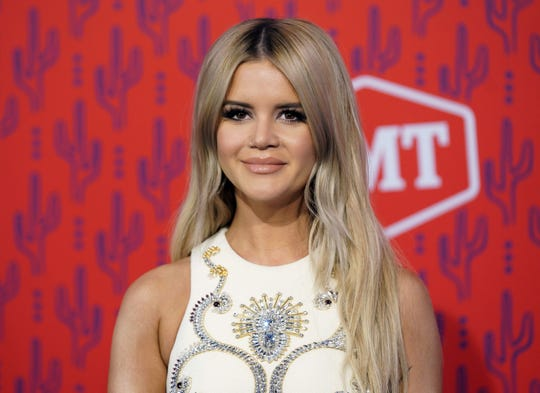 "Morris FILE - This June 5, 2019 file photo shows Maren Morris at the CMT Music Awards in Nashville, Tenn. Morris has a chance to win up to eight trophies including for album of the year at the 2019 Country Music Association Awards thanks to her work as an artist, songwriter and producer. With the success of her album ""GIRL,"" Morris scored nominations like single of the year, song of the year, and female vocalist of the year. The CMAs will air live on Nov. 13. (AP Photo/Sanford Myers, File)"