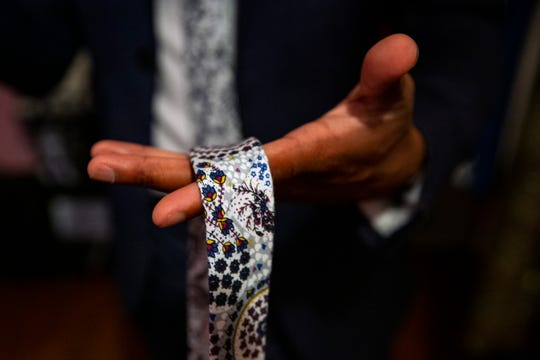 Peter Jean-Marie talks about the ties he designs during an interview, Tuesday, March 3, 2020, at his home in East Naples.