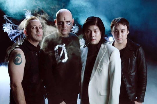 Smashing Pumpkins are Jimmy Chamberlain, from left, Billy Corgan, James Iha and Jeff Schroeder.