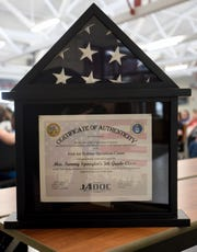 Johnstown Elementary fifth teacher Tammy Spangler was presented with a framed tri-folded American flag and certificate in appreciation for letters her students wrote to deployed soldiers just before Christmas.