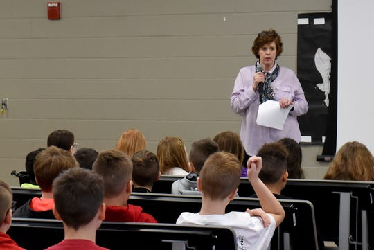 Tracy Hettinger, who retired after nearly 29 years in the Army National Guard, talks to Johnstown Elementary fifth graders about leadership lessons and skills she learned in the military for the school's building leaders program.