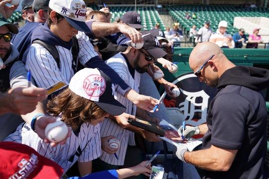 Mar 1, 2020; Lakeland, Florida, USA; New York Yankees left fielder Brett Gardner (11) signs autographs before their game against the Detroit Tigers at Publix Field at Joker Marchant Stadium.