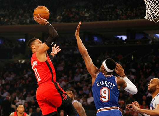 Houston Rockets guard Russell Westbrook (0) takes a shot against New York Knicks guard RJ Barrett (9) during the first half at Madison Square Garden.