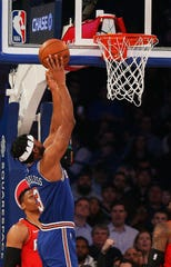 New York Knicks forward Maurice Harkless (3) goes up for a shot against the Houston Rockets during the first half at Madison Square Garden.